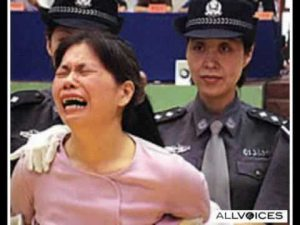 detained woman wailing with police