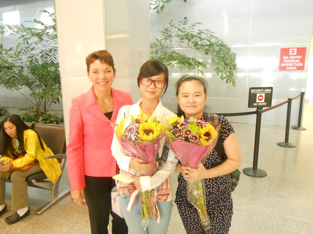 Littlejohn greets Anni and Ruli Zhang at the San Francisco Airport on September 7, 2013.