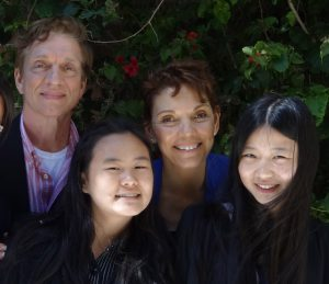 Anni and Lily Zhang, safely in San Francisco with Reggie Littlejohn and her husband, Robert