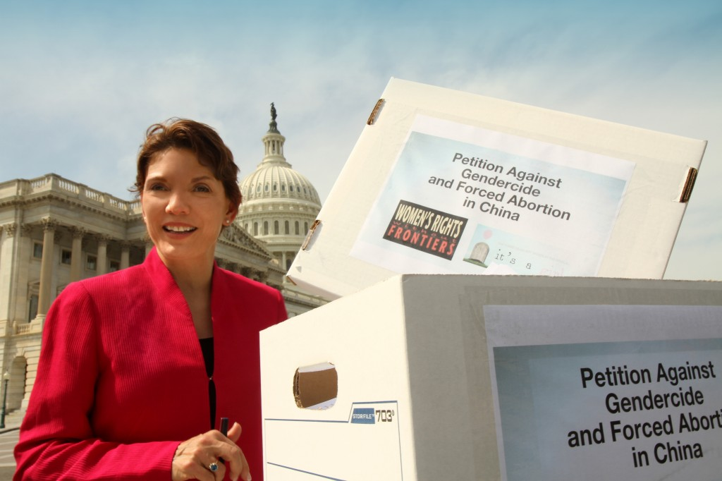 Littlejohn at a Congressional press conference, with 200,000 signatures on a petition to end gendercide and forced abortion in China. Littlejohn and Cong. Chris Smith attempted to deliver these to the Chinese Embassy on April 24, 2013, but the Chinese Embassy refused to open its doors.