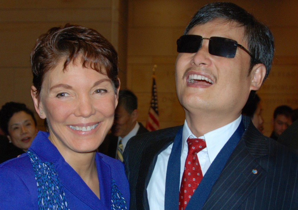 Littlejohn with blind activist Chen Guangcheng in Washington, DC in January, 2013.