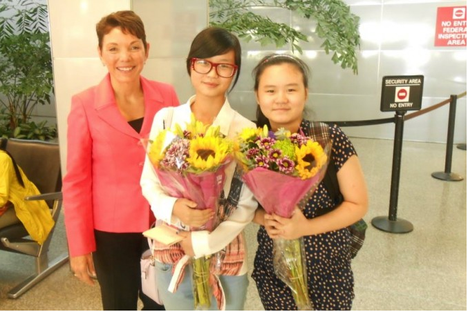 San Francisco, CA: Anni and Lily Zhang, with Reggie Littlejohn, upon their arrival in the United States, September 7, 2013
