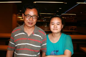 Anni with her father, Zhang Lin, before he was detained in China for advocating for her right to go to school.