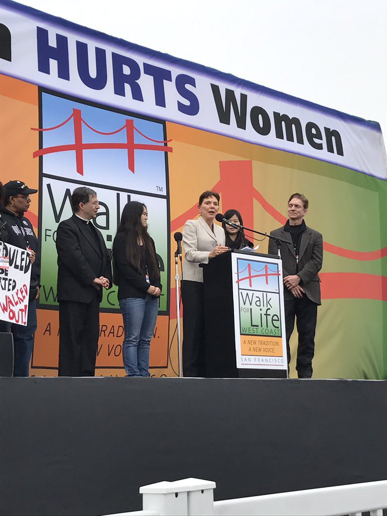 Reggie addresses 50,000 at the West Coast Walk for Life, flanked by husband Rob, daughters Anni and Ruli Zhang, Fr. Frank Pavone, President of Priests for LIfe, and Lori Hoye, Co-Head of the Issues4Life Foundation.